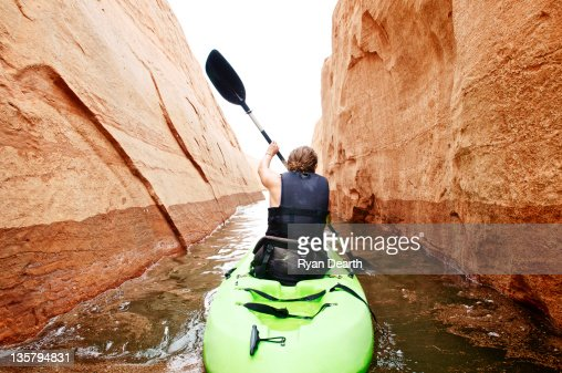 Woman paddling kayak in Canyon : Stock Photo