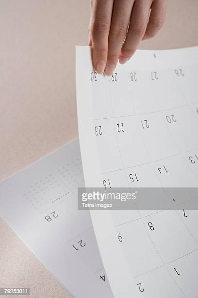 Woman paging through calendar