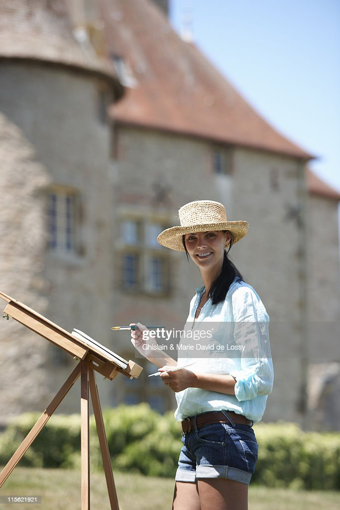 Woman painting a picture, outdoors : Stock Photo