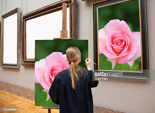 Woman painting a rose.