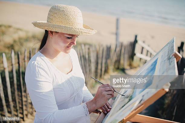 Woman painting a watercolour outdoor