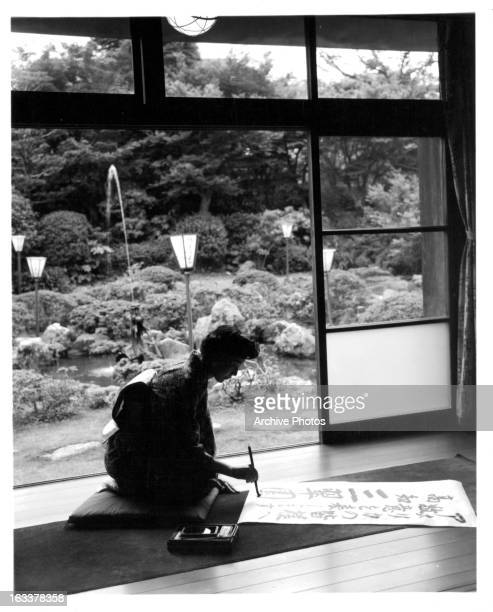 Woman painting Calligraphy in Japan 1955
