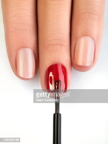 Woman painting fingernails, close-up