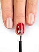 Woman painting fingernails, close-up