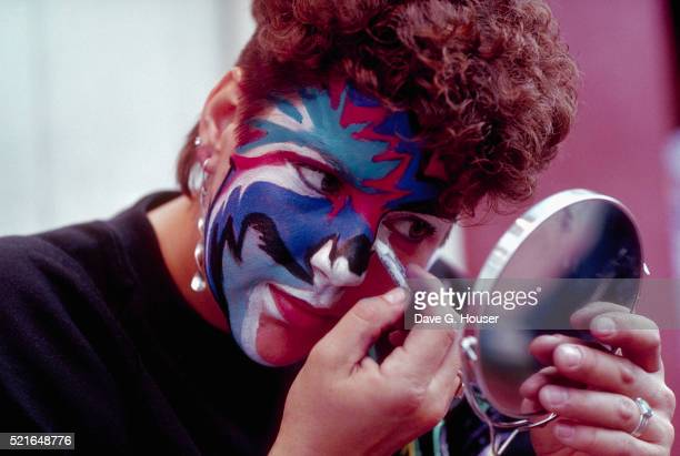 Woman Painting Her Face