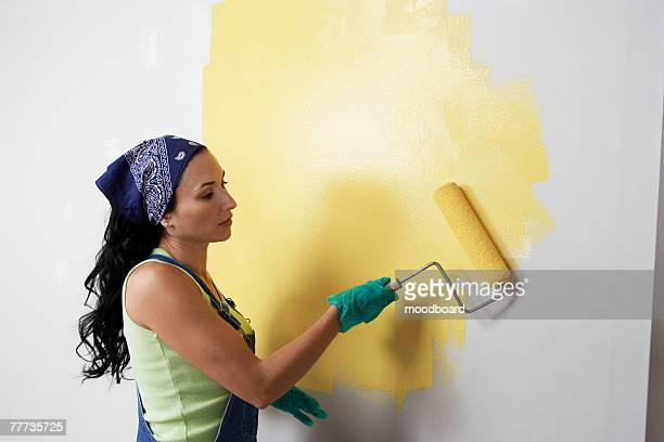 Woman Painting Room with Roller
