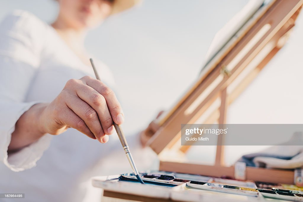 Woman painting watercolour outdoor : Stock Photo
