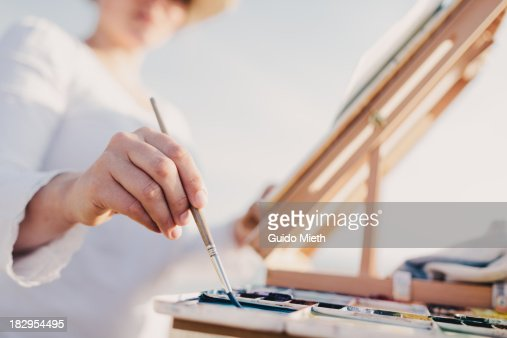 Woman painting watercolour outdoor