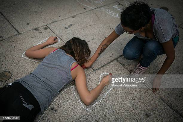 A woman paints the sillhouette of a girl during a protest against Mexican Government to demand the safe return of the 43 missing students of...