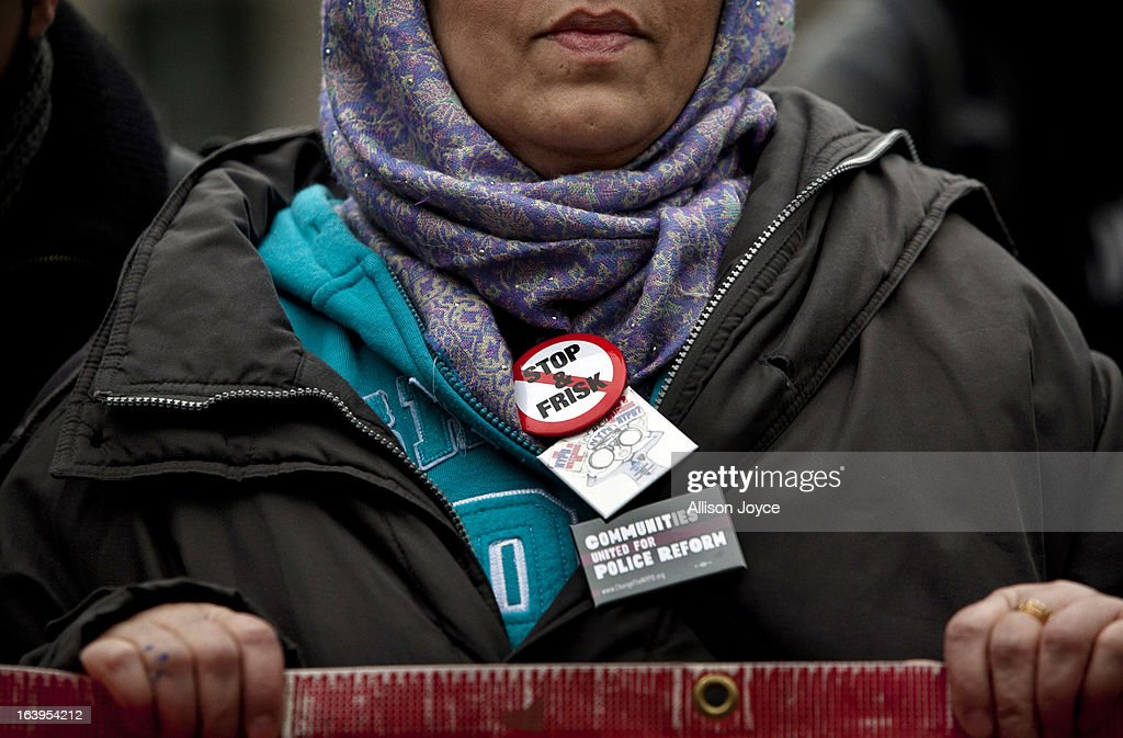 A woman participates in a demonstration against the city's 'stop and frisk' searches in lower Manhattan near Federal Court March 18, 2013 in New York City. Hearings in a federal lawsuit filed by four black men against the city police department's 'stop and frisk' searches starts today in Manhattan Federal Court.