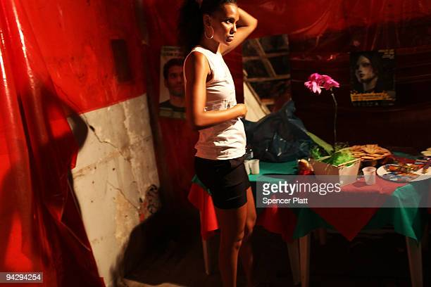 A woman participates in a fashion show in the red light district Vila Mimosa with clothes designed by sex workers on December 11 2009 in Rio de...