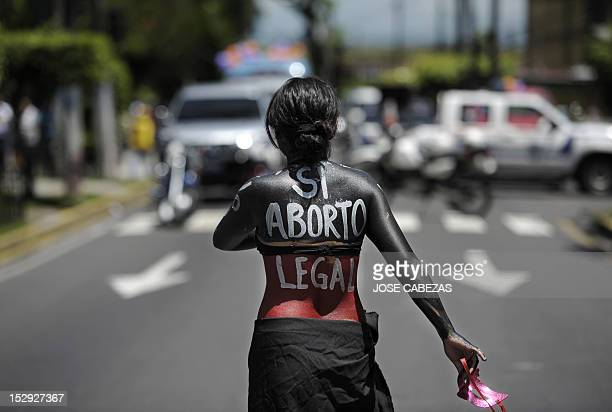 A woman participates in a march on the International Day of Action for the Decriminalization of Abortion on September 28 2012 in San Salvador...