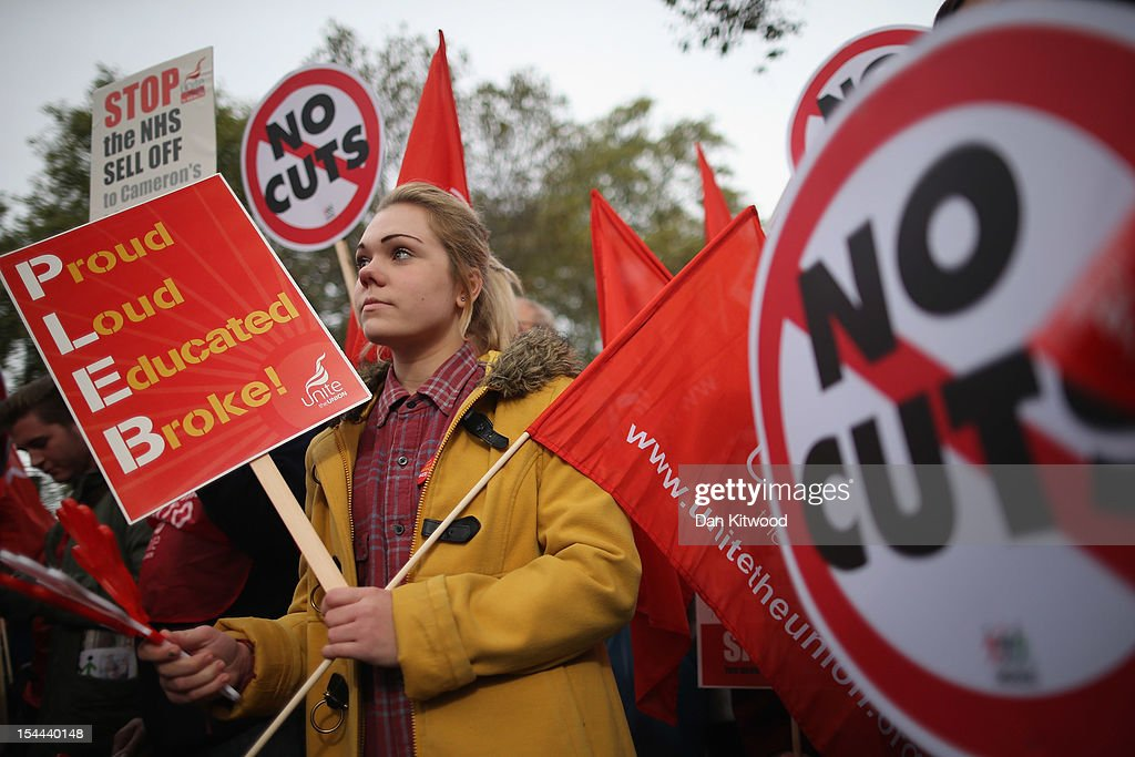 A woman participates in a TUC march in protest against the government's austerity measures on the Embankment on October 20, 2012 in London, England. Thousands of people are taking part in the Trades Union Congress (TUC) organised anti-cuts march that ends with a rally in Hyde Park, where Labour leader Ed Miliband is scheduled to address the demonstrators.