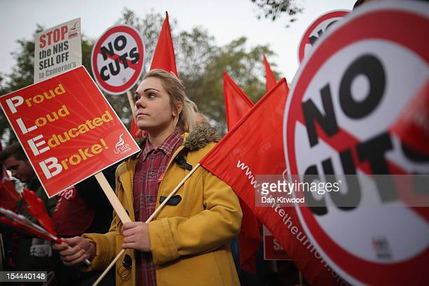 A woman participates in a TUC march in protest against the government's austerity measures on the Embankment on October 20 2012 in London England...