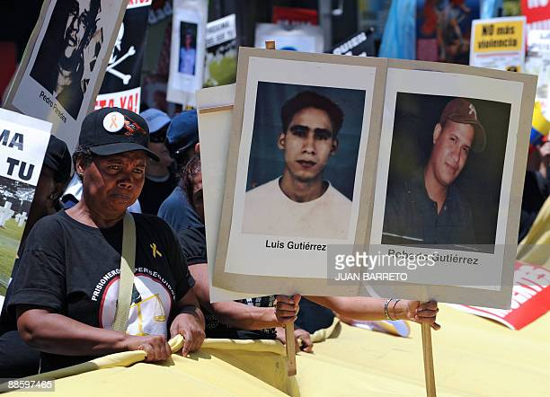 A woman participates of a demonstration against the lack of safety on the streets next to signs with pictures of murdered men on June 20 2009 in...