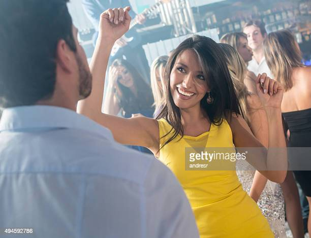 Woman partying at a nightclub