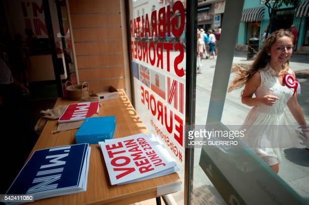 A woman passes by a Remain campaign office during the referendum on whether the United Kingdom should stay in or leave the European Union in...