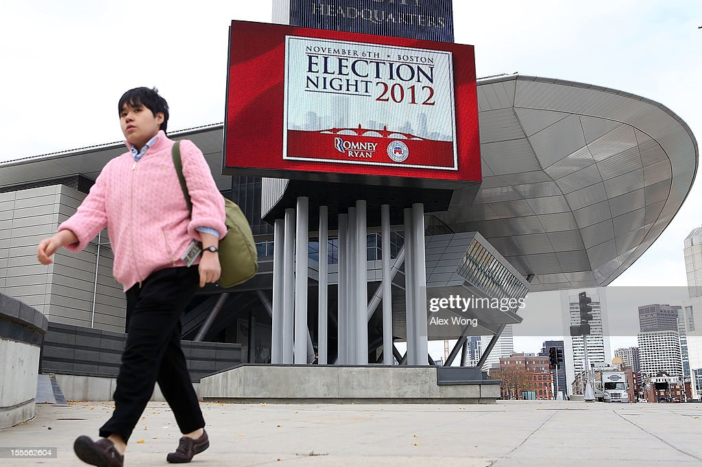 A woman passes by the Boston Convention and Exhibition Center November 5, 2012 in Boston, Massachusetts. Mitt Romney will hold his election night event tomorrow at the venue.