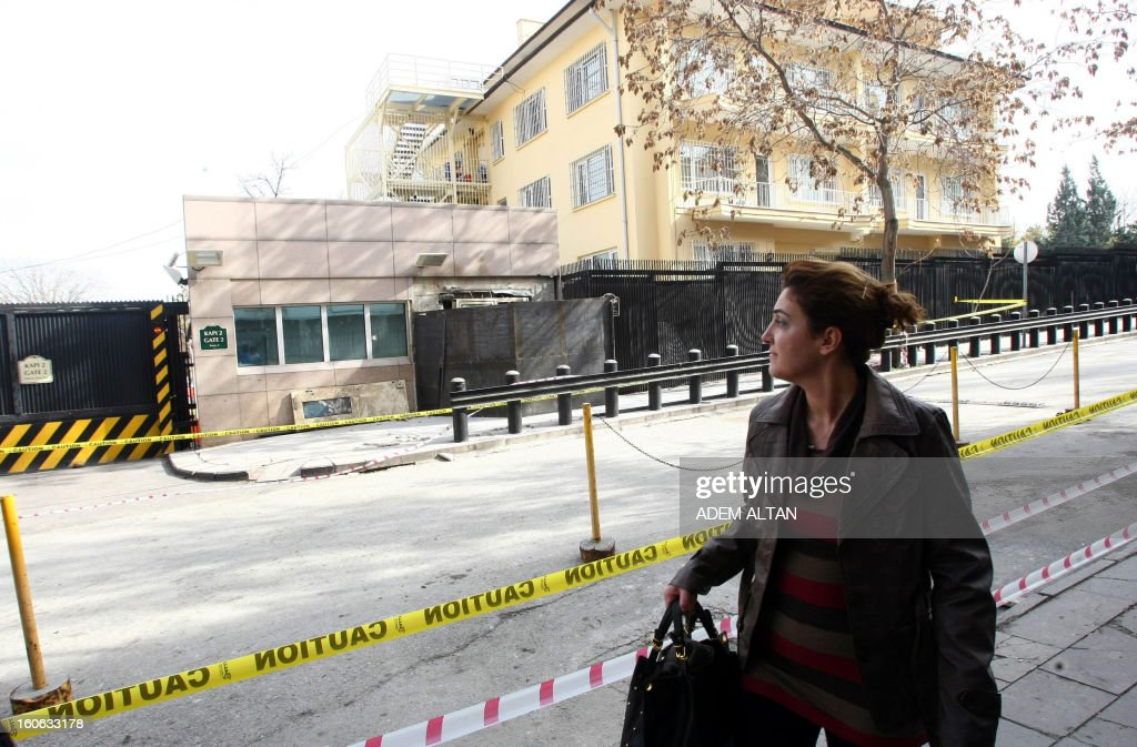 A woman passes by the side entrance of the U. S. embassy in Ankara, closed with metal, on February 4, 2013 three days after a suicide bomber blew himself up outside the embassy. The US Marines call for a minute of silence in the embassy in Ankara in honor of security guard Mehmet Akarsu, who was killed in a suicide bomb attack on Friday.