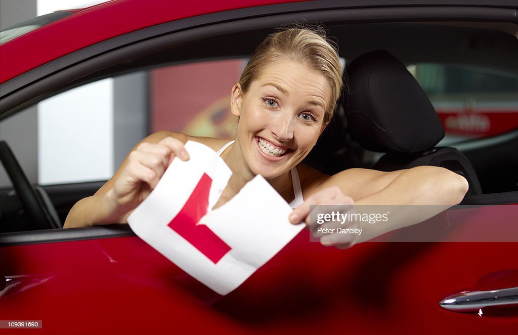 Woman passes driving test : Stock Photo
