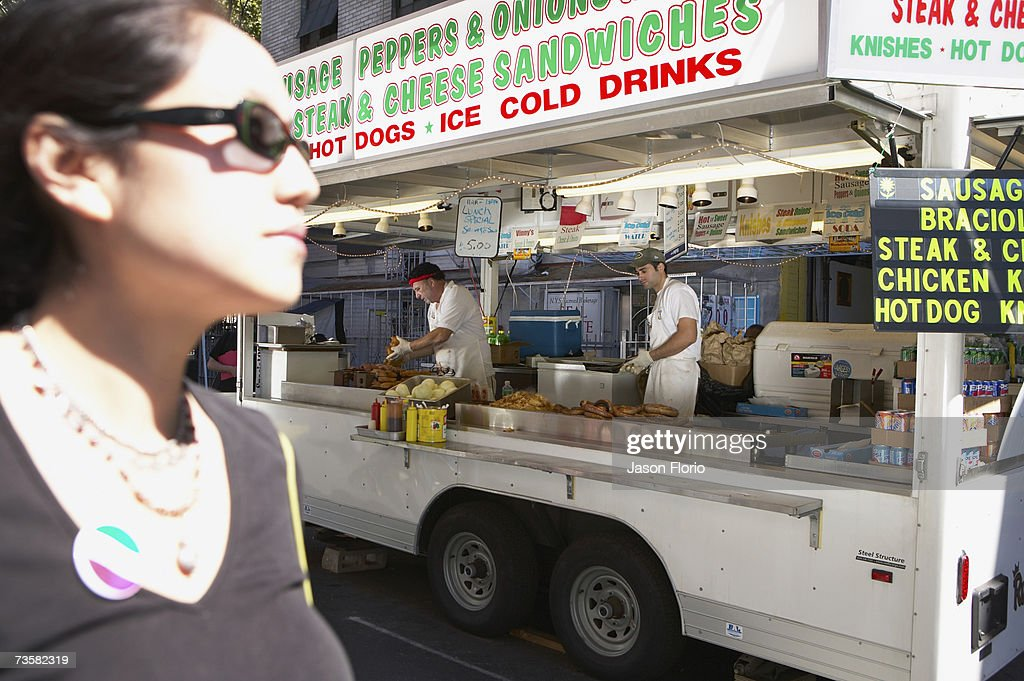 Woman passing snack stand