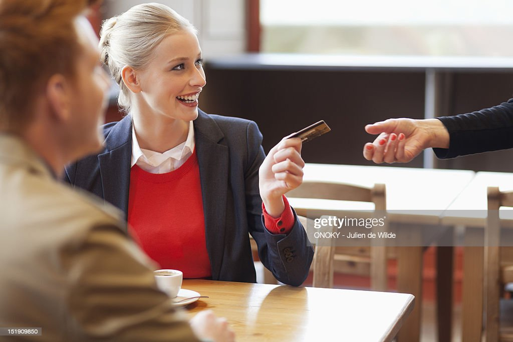 Woman paying bill by credit card