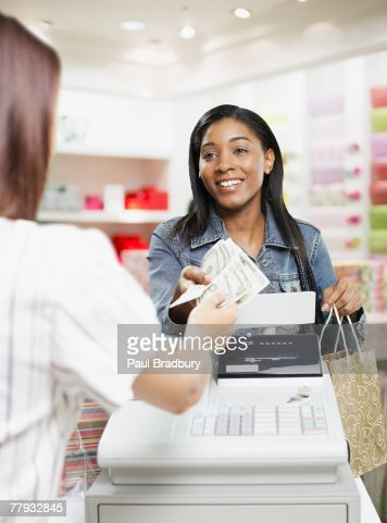 man paying for items at a cashier in store stock photo getty images