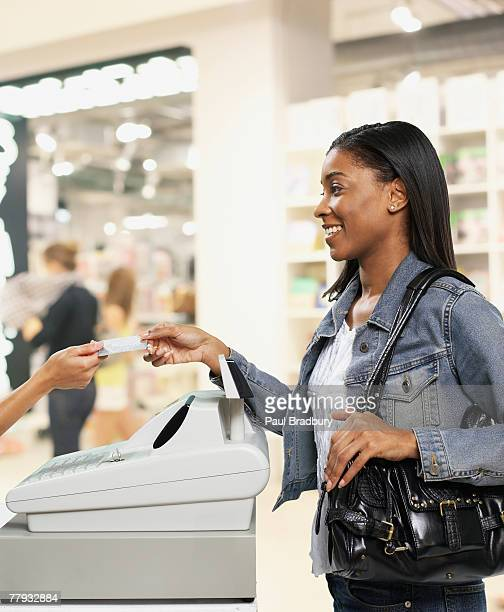 Woman paying for items at cashier in store