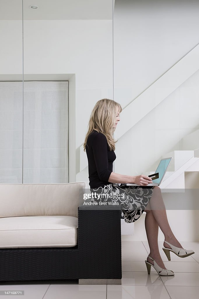 Woman paying for on-line services with credit card : Stock Photo