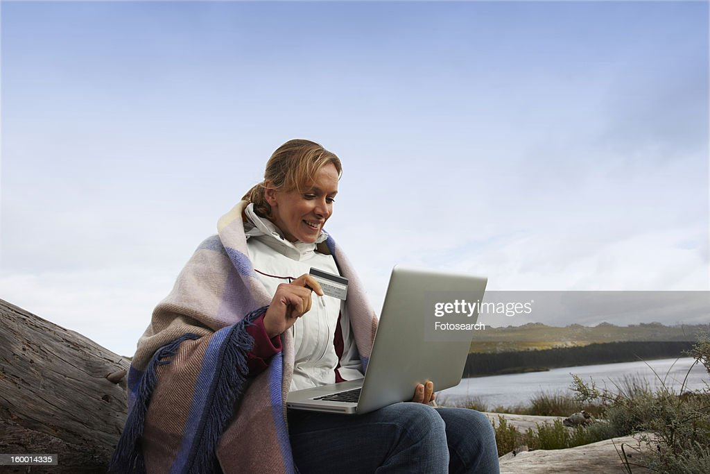 Woman paying online : Stock Photo
