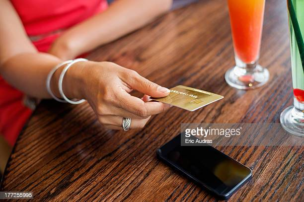 Woman paying with a credit card on a table in a restaurant