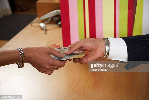 Woman paying with cash in store