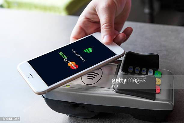 Woman paying with mobile phone