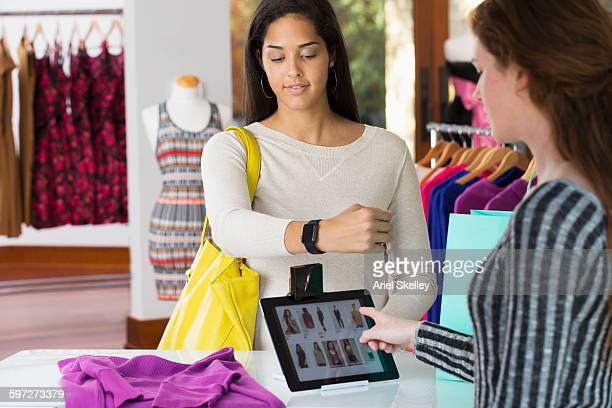 Woman paying with smart watch in store