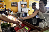 Woman pays a bill in a coffee bar on July 6 2015 in Athens Greece Politicians in Europe and Greece are planning emergency talks after Greek voters...