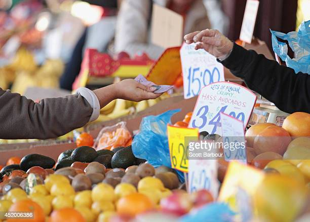 A woman pays for her purchases at the Queen Victoria Market on July 11 2014 in Melbourne Australia The 135yearold Queen Victoria Market will seek...