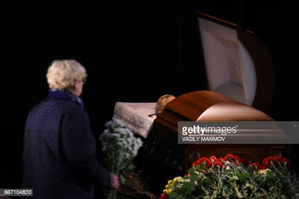 A woman pays her last tribute to poet Yevgeny Yevtushenko during a farewell ceremony at the Central House of Writers in Moscow on April 11 2017...