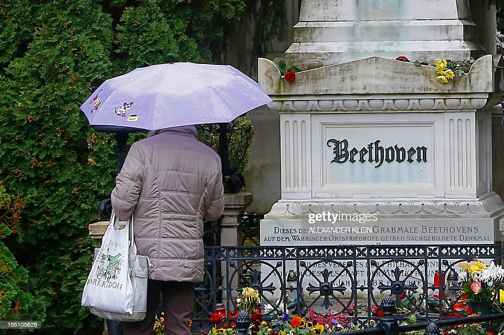 A woman pays her respect in front of the tombstone of German composer Ludwig van Beethoven at the central cemetery (Zentralfriedhof) in Vienna, on November 1, 2012. People celebrate the Catholic All Saints' Day on November 1, visiting tombstones of relatives and paying their respects to the dead.