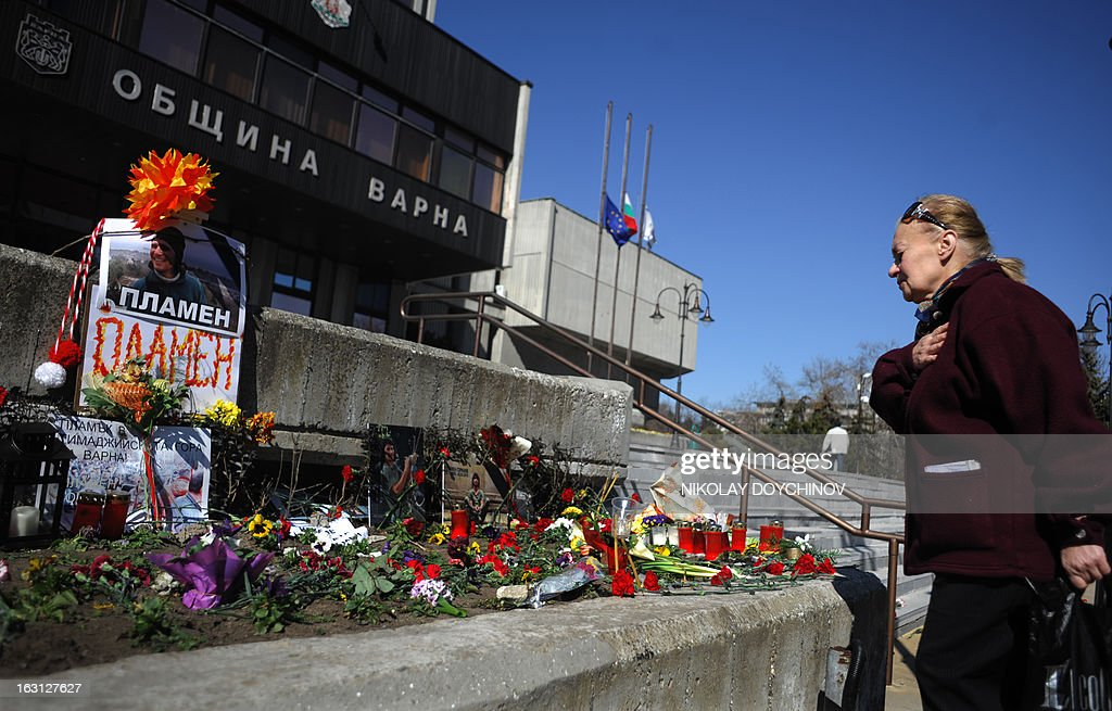 A woman pays respect on March 5, 2013 outside the city hall of Varna, on the site where a man who became a symbol of the three-week wave of protests against corruption, set himself on fire. Plamen Goranov, a 36-year-old amateur photographer and rock climber, died the day before after setting himself ablaze on February 20 in the Black Sea city of Varna. Goranov's self-immolation prompted Varna protestors to adopt his cause and turn their initial anger over high electricity bills against the long-time mayor, whom they accused of corruption and favouritism towards a local business group.