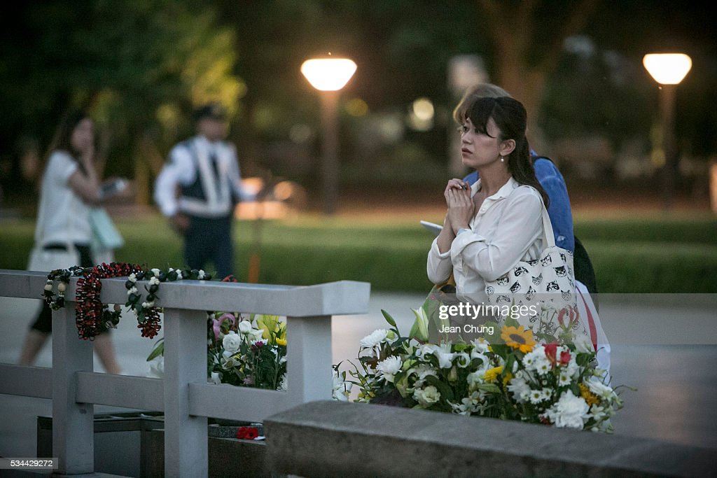 A woman pays respects at the arch inside Peace Memorial Park on May 26, 2016 in Hiroshima, Japan. On May 27, President Barack Obama is scheduled to visit Hiroshima, which will be the first time a U.S. president makes an official visit to the site where an atomic bomb was dropped at the end of World War II.