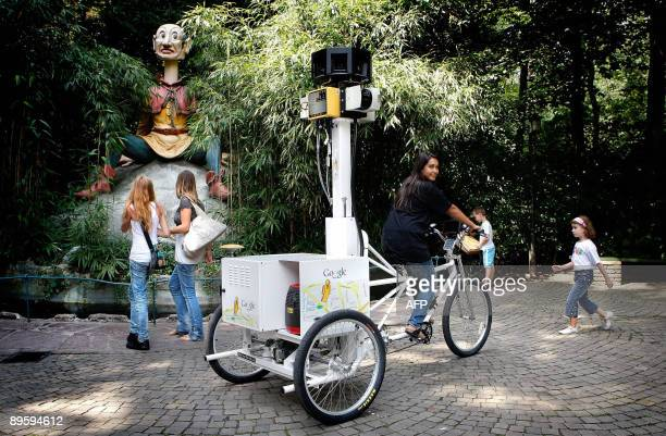 A woman pedals a tricycle fitted with a special camera in the Efteling the largest theme park in the Netherlands on August 4 2009 The images are...