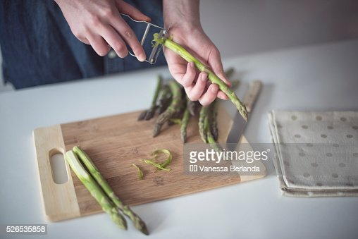 Woman peeling asparagus