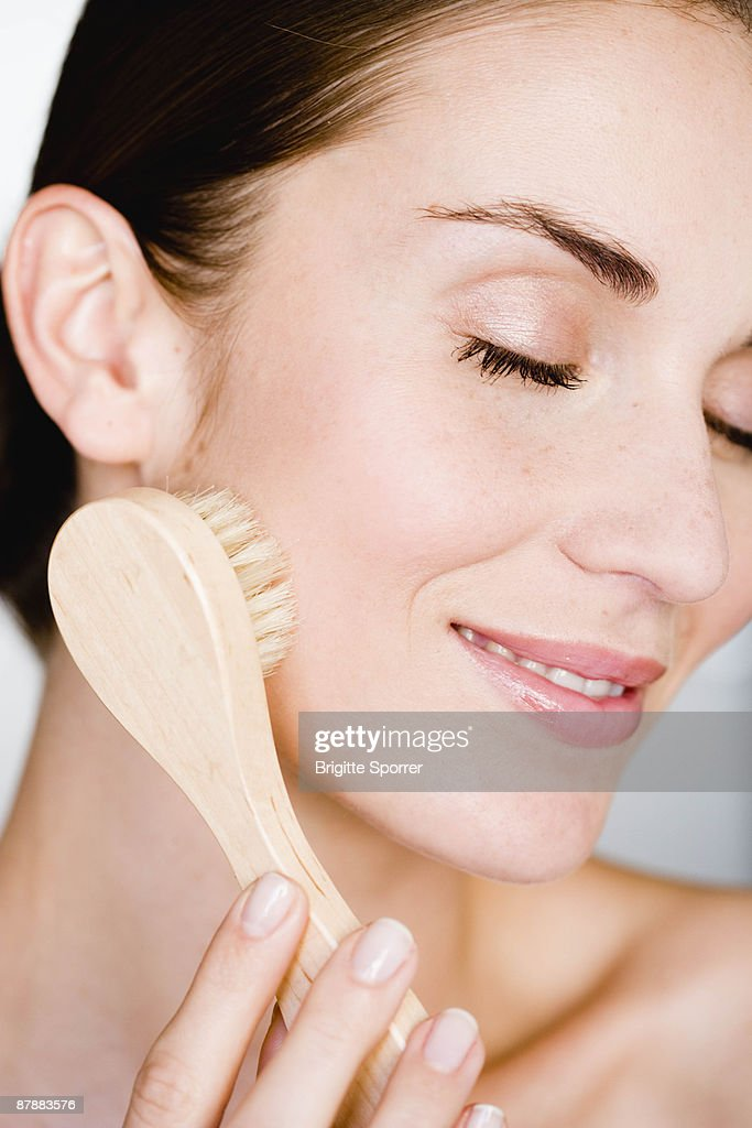 Woman peeling her face