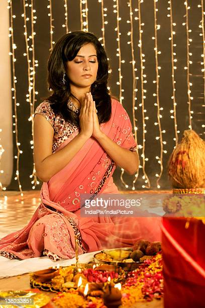 Woman performing a pooja