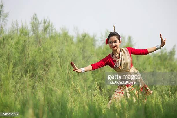 Woman performing Bihu dance
