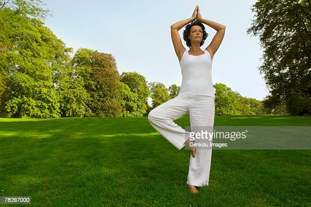 A woman performing yoga.