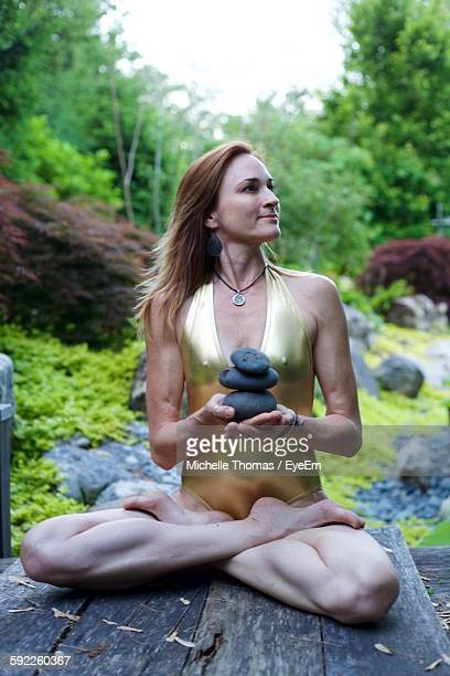 Woman Performing Yoga While Looking Away In Park