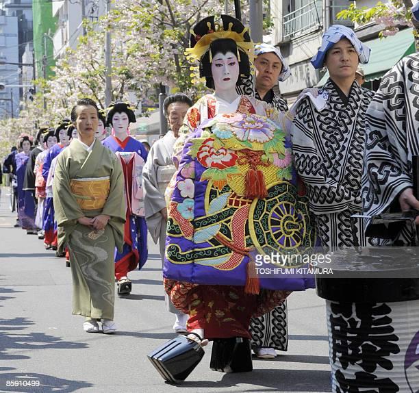 A woman performs as an 'Oiran' the highclass courtesans in the Edo period walking on platform 'Geta' sandals during the 'Edo Yoshiwara Oiran Dochu'...