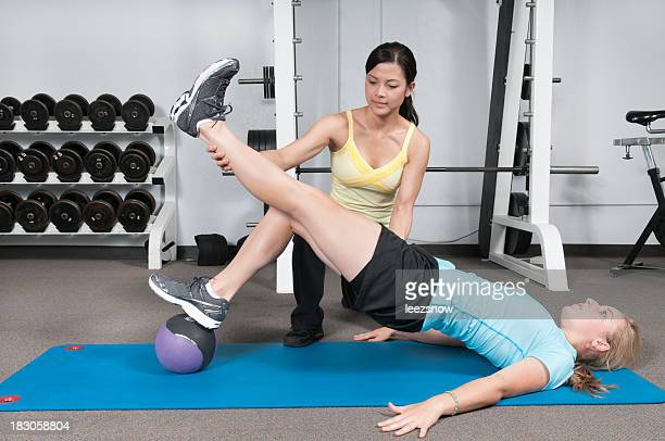 Woman Personal Trainer Working With Client