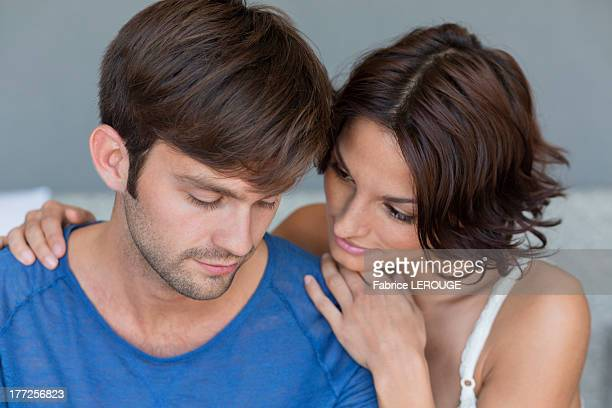 Woman persuading her upset husband